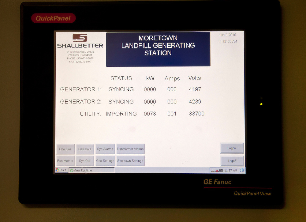 Digital monitor screen showing status of methane gas powered electricity generator at Waste to Energy plant located at sanitary landfill
