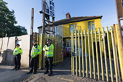 © Licensed to London News Pictures. 05/06/2017. LONDON, UK.  Police officers stand outside a residential property close to the Ship and Shovel pub in Dagenham this morning, where armed officers had been seen first thing. Police carried out a raid at a Dagenham address early this morning in connection with the London Bridge terror attacks and residents reported hearing gun shots.  Photo credit: Vickie Flores/LNP