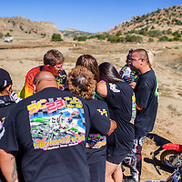 100414       Cable Hoover<br /> <br /> Todd Costley, center, leads a prayer for his son Scott Costley at the start of the Scott Costley memorial motocross race at the Gallup OHV MX Park Saturday. Scott Costley was killed Sept. 25, 2009 when the truck he was driving was struck by a drunk driver.