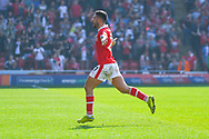 Alex Mowatt of Barnsley (27) scores a goal and celebrates to make the score 1-0 during the EFL Sky Bet League 1 match between Barnsley and Shrewsbury Town at Oakwell, Barnsley, England on 19 April 2019.