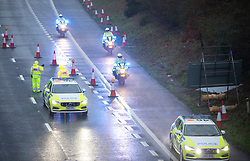 © Licensed to London News Pictures. 21/12/2020. Hollingbourne, UK. Police on the M20 in Kent, A major police operation is underway in Kent as Operation Stack is implemented on the M20 due to the Port of Dover and Channel Tunnel having to close in response to France closing its borders to the UK.  All freight and passenger traffic have been banned for 48 hours due to the new mutant strain of the Coronavirus in England. traffic. Photo credit:Grant Falvey/LNP