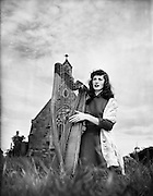 Harpist Mary O'Hara, Clontarf, before leaving for South Africa.28/05/1954..Mary O'Hara (born in Sligo on 12th May 1935) is an Irish soprano and harpist from County Sligo. O'Hara achieved fame on both sides of the Atlantic in the late 1950s and early 1960s. Her recordings of that period influenced a generation of Irish female singers who credit O'Hara with influencing their style, among them Carmel Quinn, Mary Black, and Moya Brennan, among others. In his autobiography Memoirs of an Irish Troubadour (2002) Liam Clancy wrote how O'Hara's music inspired and influenced him and others of the Folk Revival period..Her nephew is playwright and author Sebastian Barry, the son of her sister, the late actress Joan O'Hara (Eunice in Fair City on RTÉ-TV)