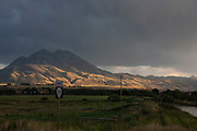 Emigrant Peak is illuminated by the evening sun, at a junction of roads at Emigrant in Paradise Valley, near Livingstone, Montana. In Big Sky Country the landscapes never disappoint, and constantly amaze. The golden evening sun combined with the could darkened sky proves a good combination.