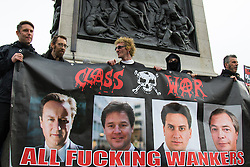 London, May 27th 2015. Members of anarchist group Class War hold up their banner with its forthright message against the mainstream ploitical leadership  on the day the Queen delivered her speech to Parliament