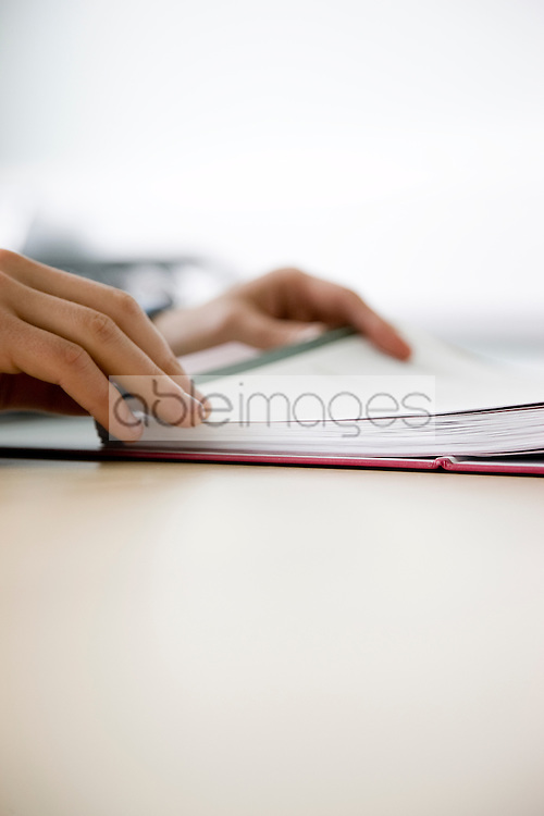 Close up of man's hands checking file