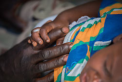 2 November 2019, Ganta, Liberia: A young boy receives emergency treatment at the Ganta Hospital. Located in Nimba county, the Ganta United Methodist Hospital serves tens of thousands of patients each year. It is a founding member of the Christian Health Association of Liberia.
