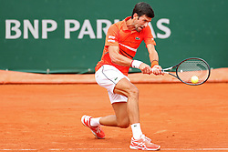 May 30, 2019 - Paris, France - Novak Djokovic (SRB) gets low for a backhand during the French Open Tennis at Stade Roland-Garros, Paris on Thursday 30th May 2019. (Credit Image: © Mi News/NurPhoto via ZUMA Press)