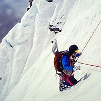 Mountaineer on the North headwall of Baruntse, Nepal