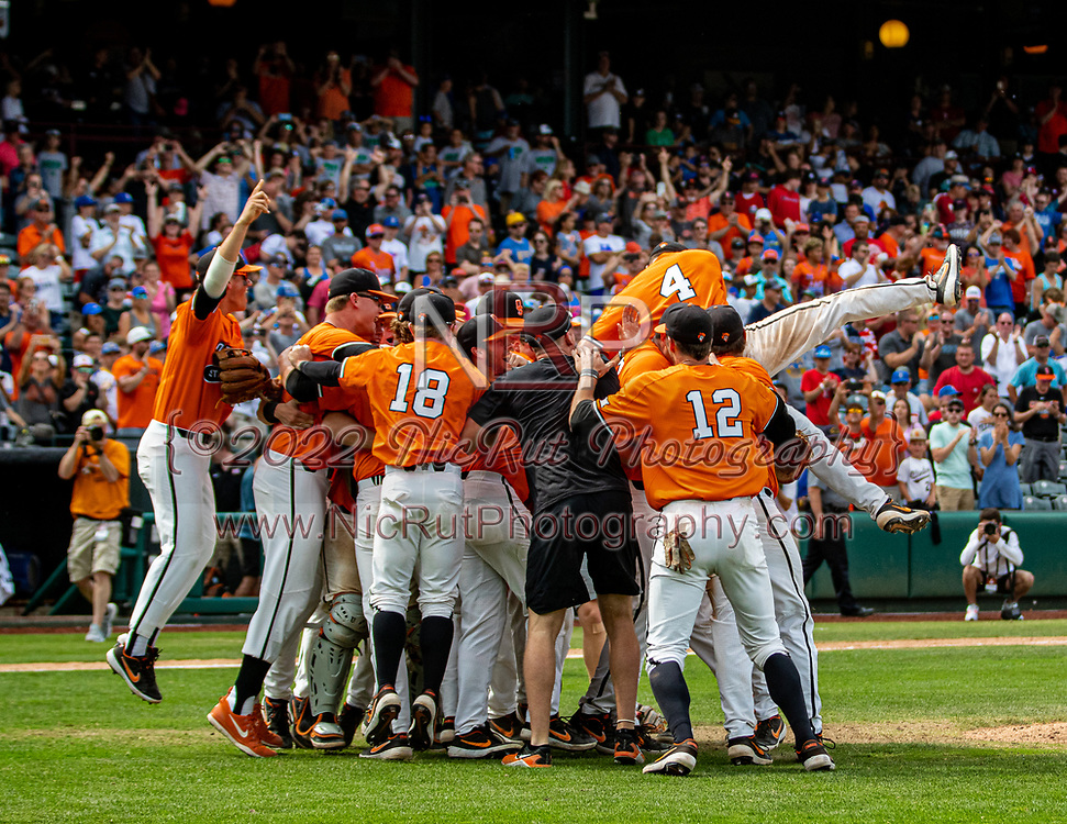 Players gathered in front on the pitchers mound after defeating the West Virginia Mountaineers during during the Big 12 Championship Game on Sunday, May 26, 2019 at the Chickasaw Bricktown Ballpark in Oklahoma City, OK.