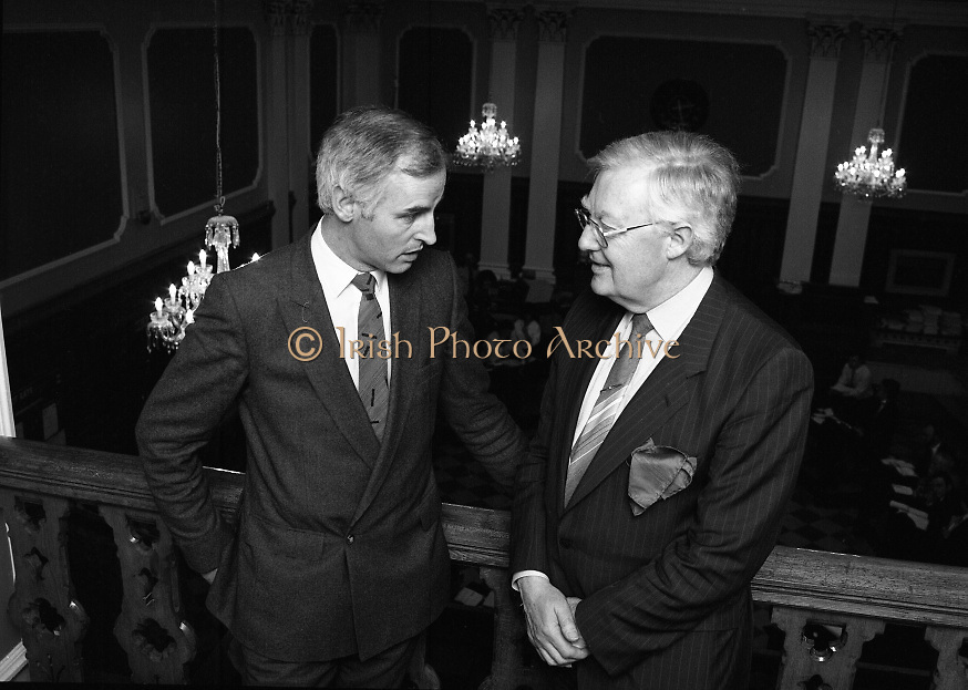 """Mr Angus McDonnell (left), President of the Stock Exchange and Mr Owen Kealy, Managing Director, Waterford Glass Group visiting the Stock Exchange to view the newly installed chandeliers.<br /> <br /> Waterford Glass Chandeliers in the Stock Exchange 18th December 1985..The installation of four Water Crystal Chandeliers over the trading floor in the Stock Exchange added an air of elegance to the room. It was regarded by many as the """"Highlight"""" of this Christmas period."""