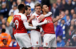 Arsenal's Pierre-Emerick Aubameyang (right) celebrates scoring his side's first goal of the game from the penlaty spot with team mates during the Premier League match at the Emirates Stadium, London.