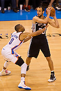 June 2, 2012; Oklahoma City, OK, USA; Oklahoma City Thunder guard Russell Westbrook (0) applies pressure as San Antonio Spurs guard Manu Ginobili (20) looks to make a pass during a playoff game  at Chesapeake Energy Arena.  Thunder defeated the Spurs 109-103 Mandatory Credit: Beth Hall-US PRESSWIRE
