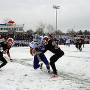 Myles Ridder, Darien, is tackled during the New Canaan Rams Vs Darien Blue Wave, CIAC Football Championship Class L Final at Boyle Stadium, Stamford. The New Canaan Rams won the match in snowy conditions 44-12. Stamford,  Connecticut, USA. 14th December 2013. Photo Tim Clayton