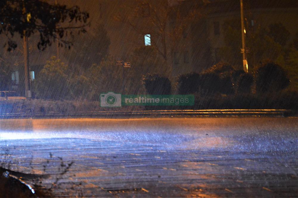 January 3, 2018 - Ankara, Turkey - A car's headlights illuminate rain drops on a rain-drenched road as heavy rain falls in the winter season in Ankara, Turkey on January 3, 2018. (Credit Image: © Altan Gocher/NurPhoto via ZUMA Press)