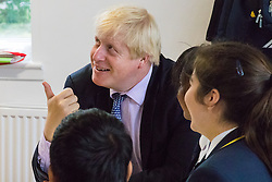 Michaela Community School, Wembley, London, June 23rd 2015. Mayor of London Boris Johnson visits the Michaela Community School, a Free School in Wembley that started taking students in September2014 after battling a certain amount of resistance from locals and unions. During the visit Head Teacher Katharine Birbalsingh took the Mayor on a tour of the school before he participated in a history lesson, prior to sitting down with pupils for brunch. PICTURED: The Mayor of London Boris Johnson enjoys a joke with pupils over brunch.