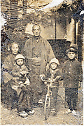 deteriorating family group portrait Japan 1914