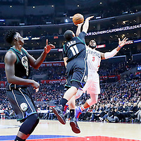16 December 2015: Los Angeles Clippers guard Chris Paul (3) goes for the jump shot over Milwaukee Bucks guard Tyler Ennis (11) during the Los Angeles Clippers 103-90 victory over the Milwaukee Bucks, at the Staples Center, Los Angeles, California, USA.