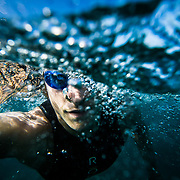 Red Bull Triathlete Jesse Thomas out on a training swim in Kailua Kona, Big Island, Hawaii.
