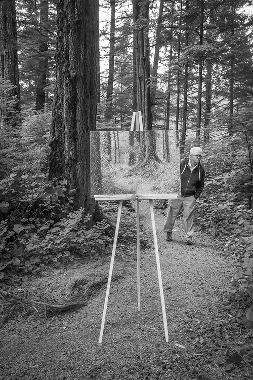 Photgrapher Clark James Mishler's self portrait features his painting of a small section of wilderness in Sitka's Totem National Historic Park during the Sitka Arts and Science Festival.