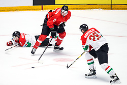 Scott Macaulay of Hungary, Tadas Kumeliauskas of Lithuania and Istvan Bartalis of Hungary during ice hockey match between Lithuania and Hungary at IIHF World Championship DIV. I Group A Kazakhstan 2019, on May 2, 2019 in Barys Arena, Nur-Sultan, Kazakhstan. Photo by Matic Klansek Velej / Sportida