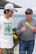 Dr. Steve Turnbull of the University of New Brunswick holds a Xeos satellite tag which will be used to track a porbeagle shark, Lamna nasus, in the Bay of Fundy, New Brunswick, Canada and discusses research plan with Joey Pratt, Director of Research of the Canadian Shark Conservation Society
