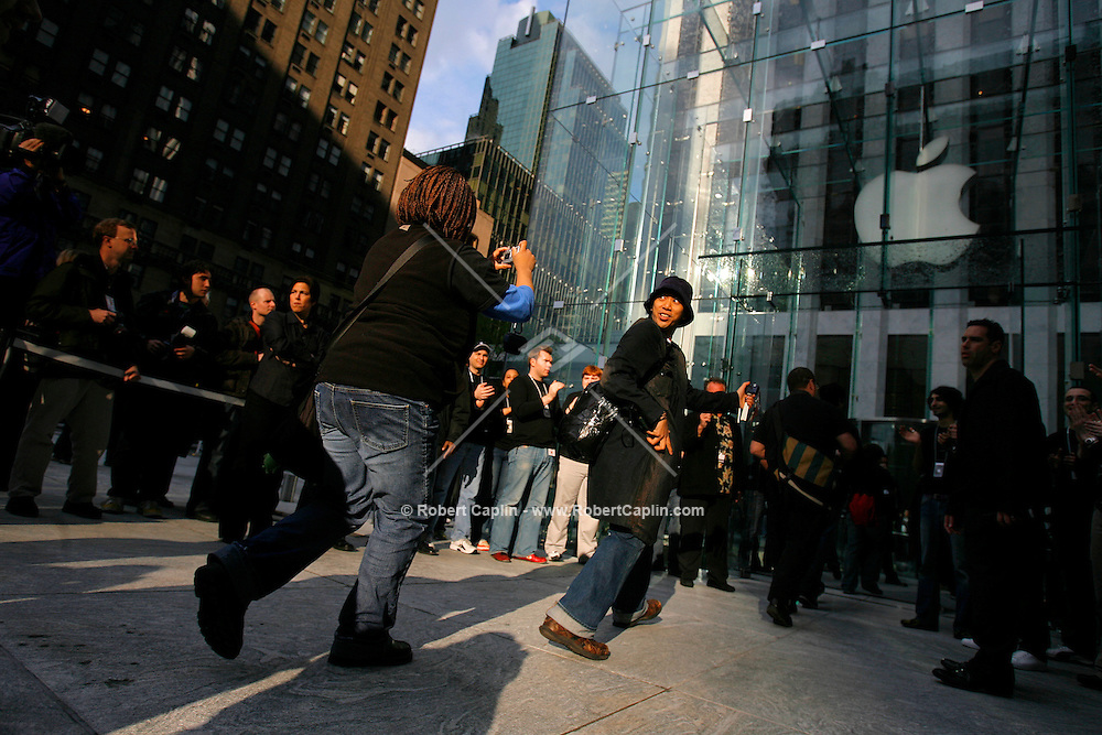 Some of the first customers walk into the new Apple Store in New York on Friday, May 19, 2006. Apple Computer Inc., maker of the iPod music player, opened a 24-hour subterranean store in New York City, marking five years in retailing with an outlet built beneath a 32-foot glass cube.