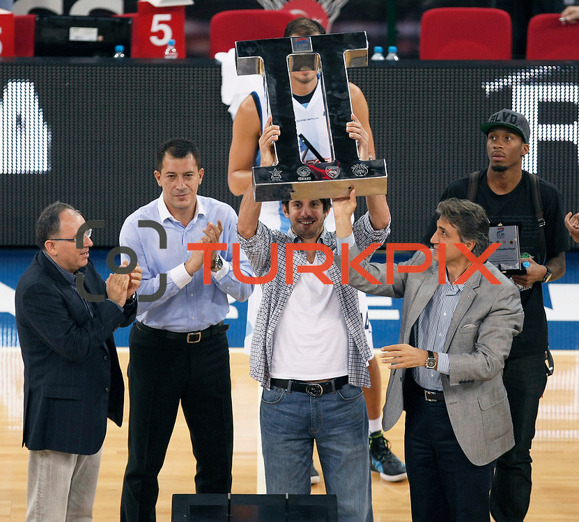 Anadolu Efes's manager Engin OZERHUN (L) head coach Ufuk SARICA (2ndL), Kerem TUNCERI (C) and Terance KINSEY (R) seen during their Two Nations Cup trophy at Abdi Ipekci Arena in Istanbul Turkey on Sunday 02 October 2011. Photo by TURKPIX