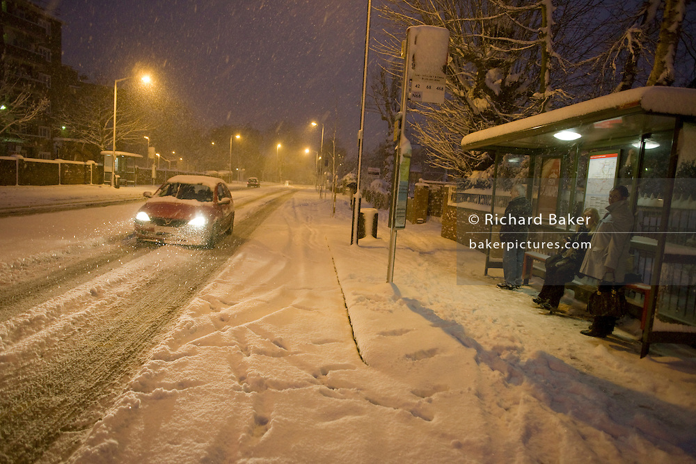 Motorists drives gingerly along Denmark Hill in South London, after unusually heavy snow falls.