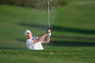 Jordan Spieth escapes from the 10th greenside bunker during the opening round of the Australian Open at The Australian Golf Club, Sydney (Photo: Anthony Powter)