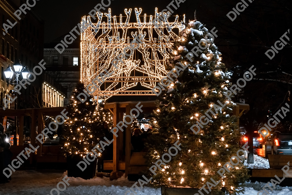 Montreal, Quebec, Canada - January 3, 2021 Traditional Christmas Tree and Chrisstmas Illuminations in Jacques-Cartier Place in Montreal Old Port at Night