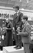 Aer Lingus Young Scientist of the Year..1971..08.01.1971..01.08.1971..8th January 1971..The annual Aer Lingus Young Scientist of the year was held in The R.D.S.Dublin.Once again, this year,there was an outstanding display of projects by school children from around the country,many of which,it is hoped,will have applications into the future. The main speaker at the event was Mr Patrick Faulkner TD, Minister for Education..Photograph of the competition winners as they take their place on the podium..(Centre) Peter J Shortt, overall winner of the Young Scientist Award,from Presentation College,Clane and both runners up, Joyce Greene,Holy Trinity College, Cork and Peter Duggan,Gonzaga College,Dublin.