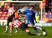 Photo: Alan Crowhurst.<br />Southampton v Cardiff City. Coca Cola Championship. 01/04/2006. Cardiff's Jason Koumas (R) is tackled by Grzegorz Rasiak.