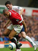 Photo. Daniel Hambury.<br />The Barclays Premiership.<br />Tottenham Hotspur V Manchester United. 25/09/2004.<br />Spurs' Robbie Keane and Manchester United's Mikael Silvestre