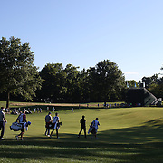 Jason Day, (right), Australia, Jordan Spieth, and Bubba Watson, (left), USA, head out on the tenth hole with their caddies during an early morning start at The Barclays Golf Tournament at The Plainfield Country Club, Edison, New Jersey, USA. 27th August 2015. Photo Tim Clayton