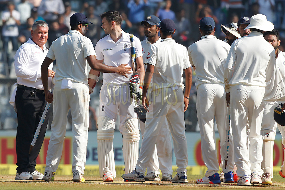 Ravichandran Ashwin of India talks with James Anderson of England during day 5 of the fourth test match between India and England held at the Wankhede Stadium, Mumbai on the 12th December 2016.<br /> <br /> Photo by: Deepak Malik/ BCCI/ SPORTZPICS