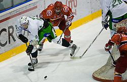 Egon Muric of Olimpija vs Tomo Hafner of Jesenice at 14th Round of EBEL league  ice hockey match between HK Acroni Jesenice and HDD Tilia Olimpija Ljubljana, on October 16, 2009, in Arena Podmezaklja, Jesenice. (Photo by Vid Ponikvar / Sportida)