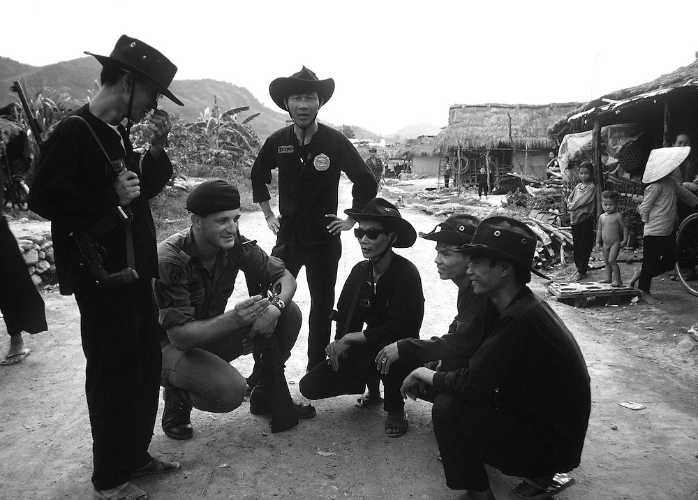 Vietnamese special forces seen meeting the local members of the South Vietnamese Defence Force in the Central Highlands, Vietnam in October 1969. Photographed by Terry Fincher