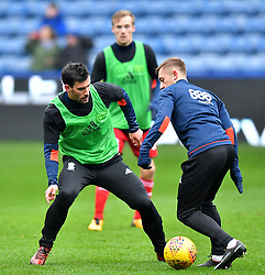 Birmingham City's Maxime Colin (left) warms up ahead of the match
