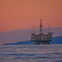 Oil drilling and pumping platforms rise out of the Pacific Ocean near Los Angeles, California.