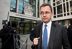 © London News Pictures. 29/11/2012. London, UK. Former editor of the News of the World  ANDREW COULSON leaving Westminster Magistrates Court in London after facing charges linked to investigation into alleged corrupt payments to public officials by journalists on November 29, 2012. The court hearing takes place on the same day that  Lord Justice Leveson is set to publish his report  into the culture and ethics of the UK's press. Photo credit: Ben Cawthra/LNP