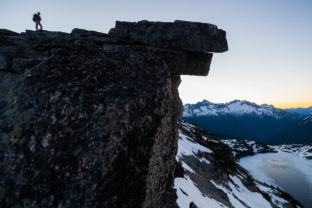 Stephen Byrne stands on a ridge overlooking Hidden Lake, North Cascades National Park, Washington.