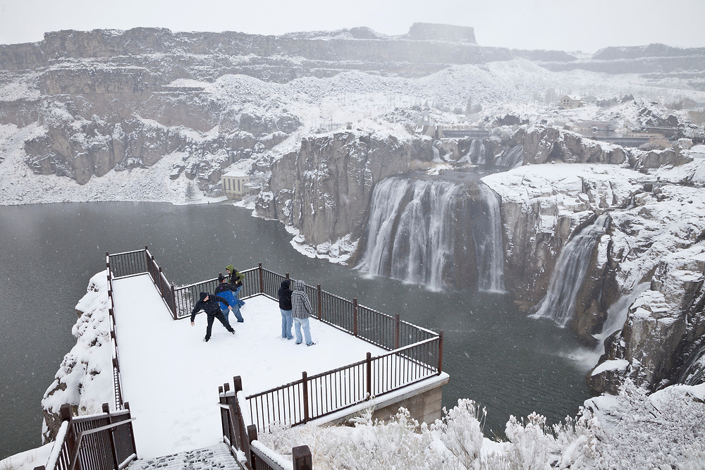 """Licensing - Open Edition Prints<br /> Shoshone Falls in snow is a waterfall on the Snake River located approximately five miles east of Twin Falls, Idaho. Sometimes called the """"Niagara of the West,"""" Shoshone Falls is 212 feet (64.7 m) high—45 feet (14 m) higher than Niagara Falls—and flows over a rim 1,000 feet (305 m) wide. Shoshone Falls has existed at least since the end of the last ice age, when the Bonneville Flood carved much of the Snake River canyon and surrounding valleys. It is a total barrier to the upstream movement of fish. The falls were the upper limit of sturgeon, and spawning runs of salmon and steelhead could not pass the falls. Yellowstone cutthroat trout lived above the falls in the same ecological niche as Rainbow Trout below it. Due to this marked difference, the World Wide Fund for Nature used Shoshone Falls as the boundary between the Upper Snake and the Columbia Unglaciated freshwater ecoregions."""