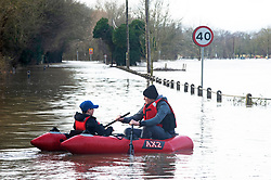 ©Licensed to London News Pictures 22/12/2019. <br /> Yalding ,UK.Two teenage boys in their boat on Lees road.  The River Medway and River Beult have bursts their banks causing severe flooding in Yalding village,Kent. Photo credit: Grant Falvey/LNP