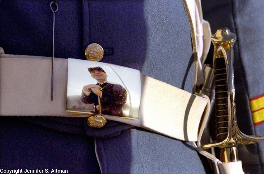 A man wearing a civil war uniform is reflected in the belt buckle of another man's costume in honor of Veteran's Day at Fort Wadsworth in Staten Island, NY.