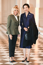 French President's wife Brigitte Macron welcomes Thailand's Prime Minister wife Naraphon Chan-ocha as they take part in a spousal event at the Chateau de Versailles in Versailles, near Paris, on November 11, 2018 as part of commemorations marking the 100th anniversary of the 11 November 1918 armistice, ending World War I. Photo By Laurent Zabulon/ABACAPRESS.COM