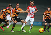Barnet midfielders Luke Gambin & Tom Champion & Exeter City midfielder Aaron Davies are focused on the ball during the Sky Bet League 2 match between Barnet and Exeter City at The Hive Stadium, London, England on 31 October 2015. Photo by Bennett Dean.