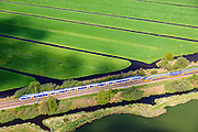 Nederland, Utrecht, Groene Hart, 09-05-2013; spoorlijn met intercity tussen Kockengen en Breukelen.<br /> Intercity railway line between Kockengen and Breukelen (Green Hart of Holland).<br /> luchtfoto (toeslag op standard tarieven)<br /> aerial photo (additional fee required)<br /> copyright foto/photo Siebe Swart