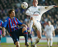 Photo: Scott Heavey<br />Crystal Palace V Leeds Ytd. 16/02/03<br />Palaces Danny Granville and Ian Harte of Leeds compete for the ball during this FA cup 5th round clash.