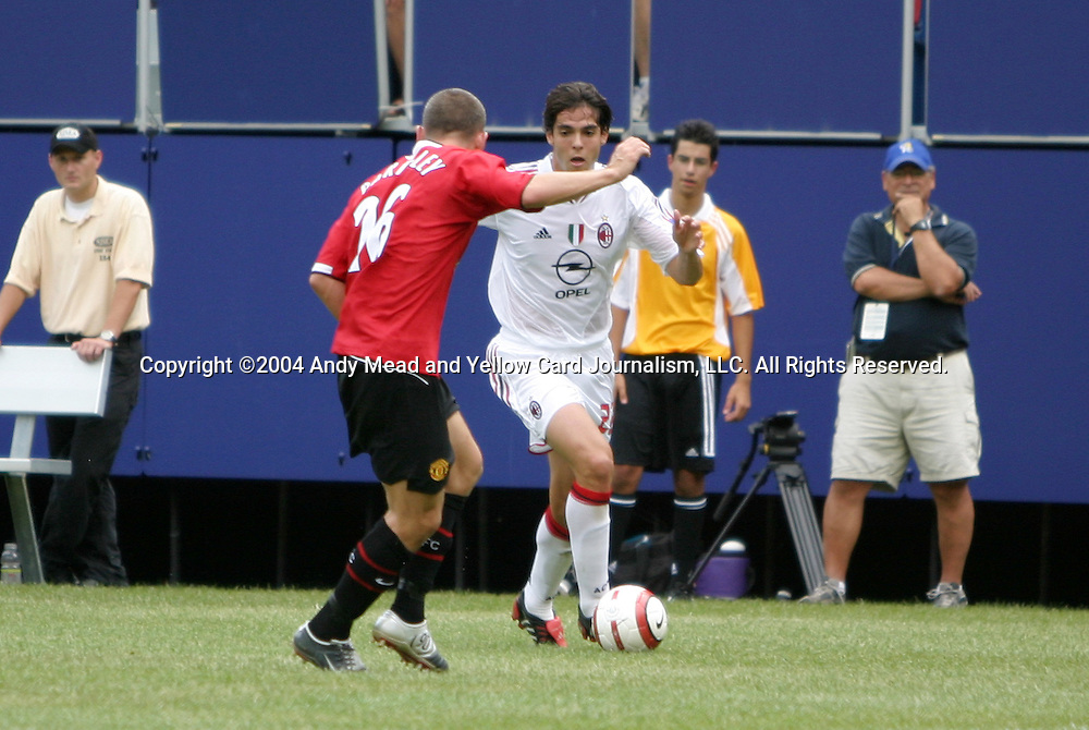 31 July 2004: Kaka (right) takes on Phil Bardsley (26) in the first half. AC Milan of Italy's La Liga defeated Manchester United of the English Premier League 9-8 on penalties after the teams played to a 1-1 draw at Giants Stadium in the Meadowlands Complex in East Rutherford, NJ in a ChampionsWorld Series friendly match..