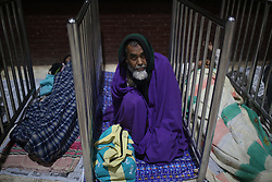December 19, 2018 - Dhaka, Bangladesh - A Bangladeshi homeless man takes shelter at railway station during cold weather in Dhaka, Bangladesh. More than 100 million people are expected to cast their votes in the upcoming general election which is will be held on December 30, 2018. (Credit Image: © Rehman Asad/NurPhoto via ZUMA Press)